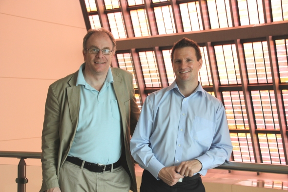 Professor Anders Hagfeldt and Dr Greg Wilson standing near the titania dye solar array.